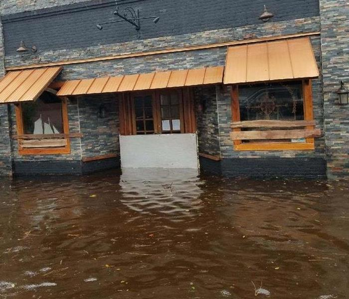 Storm waters at restaurants front door